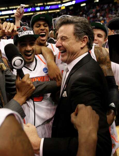 Louisville coach Rick Pitino celebrates with his players after the Cardinals held off Florida 72-68 to advance to the Final Four, which will be Pitino's fifth. Photo: Jamie Squire / 2012 Getty Images