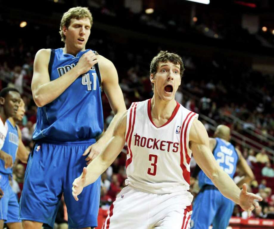 Houston Rockets' Goran Dragic (3) reacts to a foul not being called while defended by Dallas Mavericks' Dirk Nowitzki (41), of Germany, during the first half of an NBA basketball game, Saturday, March 24, 2012, in Houston. Photo: AP