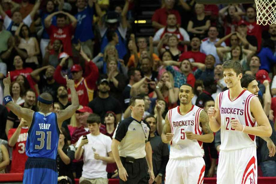Houston Rockets forward Chandler Parsons (25) and shooting guard Courtney Lee (5) react as Dallas Mavericks shooting guard Jason Terry (31) celebrates after the Rockets missed on their final shot during overtime of an NBA basketball game at Toyota Center on Saturday, March 24, 2012, in Houston. The Mavericks won the game 101-99 in overtime. Photo: Smiley N. Pool, Houston Chronicle / © 2012  Houston Chronicle