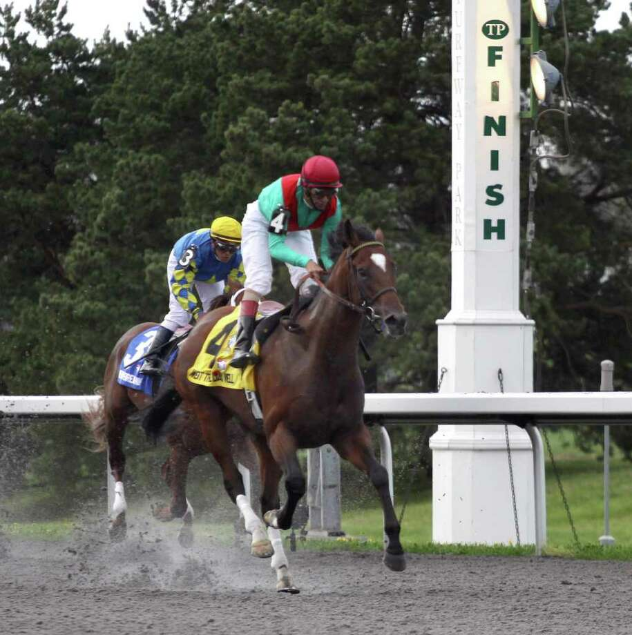 Jockey John Velazquez rides Went the Day Well, right, across the finish line in front of Heavy Breathing at the Spiral Stakes horse race at Turfway Park race track in Florence, Kentucky Saturday March 24, 2012. (AP Photo/Tom Uhlman) Photo: Tom Uhlman