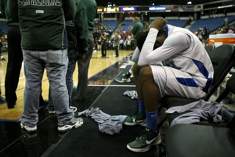 Taylor Johns sits in frustration during the Division III runners-up awards ceremony. Photo: Sean Culligan, The Chronicle
