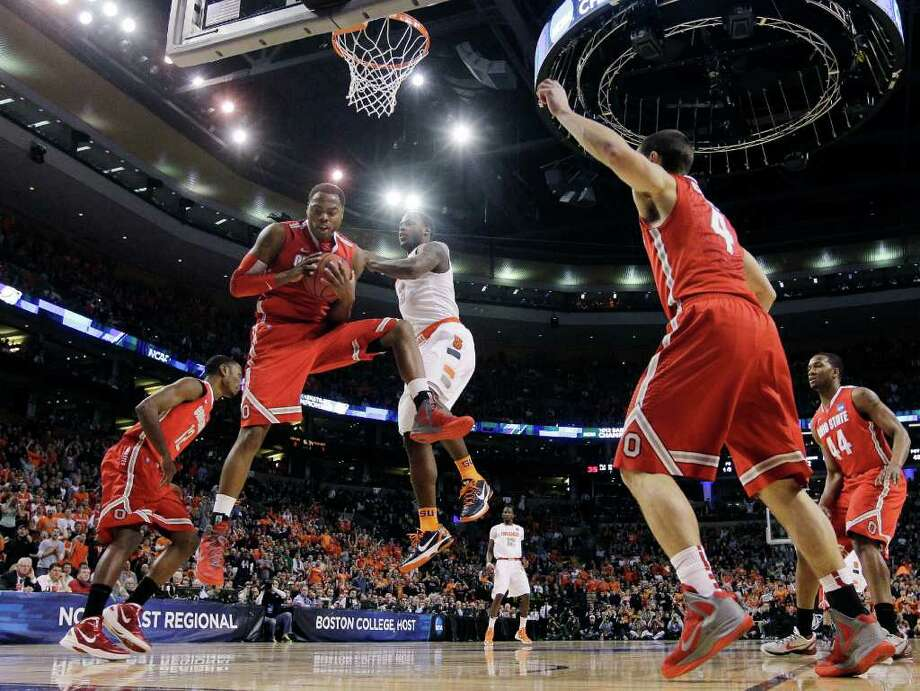 Ohio State forward Deshaun Thomas (1) grabs a rebound in front of Syracuse guard Dion Waiters (3) during the first half of the East Regional final game in the NCAA men's college basketball tournament, Saturday, March 24, 2012, in Boston. (AP Photo/Elise Amendola) Photo: Elise Amendola