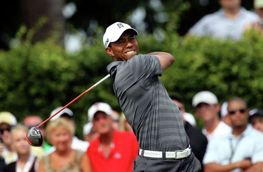 ORLANDO, FL - MARCH 24:  Tiger Woods plays a shot on the 9th hole during the third round of the Arnold Palmer Invitational presented by MasterCard at the Bay Hill Club and Lodge on March 24, 2012 in Orlando, Florida.  (Photo by Sam Greenwood/Getty Images) Photo: Sam Greenwood