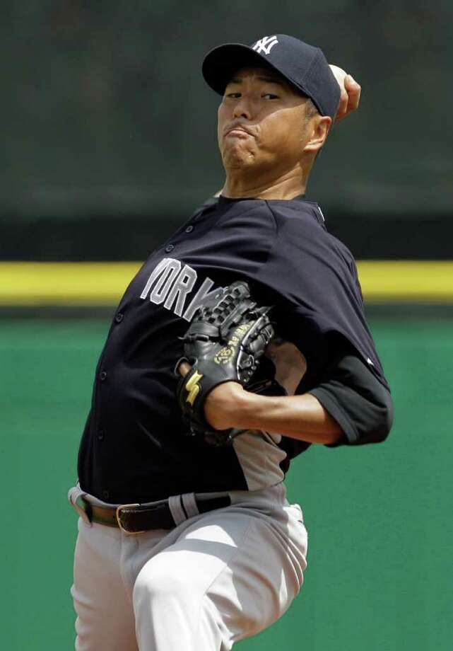 New York Yankees starting pitcher Hiroki Kuroda, of Japan, winds up during the sixth inning of a spring training baseball game against the Philadelphia Phillies at Brighthouse Field in Clearwater, Fla., Friday, March 23, 2012.  (AP Photo/Kathy Willens) Photo: Kathy Willens