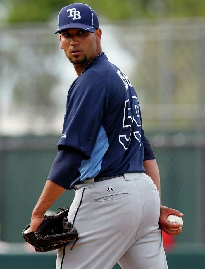 FILE - In this March 8, 2012, file photo, Tampa Bay Rays pitcher Matt Bush looks over his shoulder during a spring training baseball game in Fort Myers, Fla. The Highway Patrol says 26-year-old Bush was driving south on U.S. 41, Thursday, March 22, 2012, when he struck the motorcycle driven by 72-year-old Anthony Tufano. Bush faces multiple DUI-related charges and leaving the scene of an injury accident. (AP Photo/Charles Krupa, File) Photo: Charles Krupa