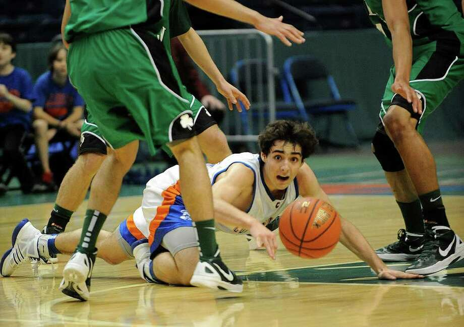 Collegiate's Ryan Frankel scrambles against Bishop Ludden for a loose ball during a Federation Tournament of Champions Class B boys' high school basketball game in Albany, N.Y., on Saturday, March 24, 2012. (AP Photo/Hans Pennink) Photo: Hans Pennink