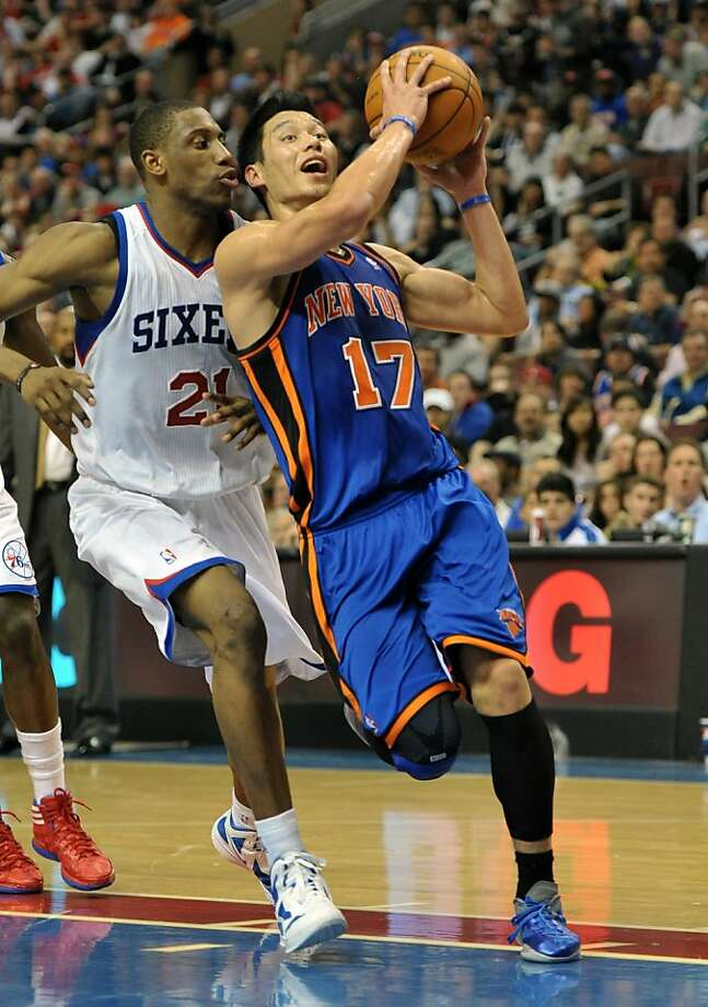 PHILADELPHIA, PA - MARCH 21: Jeremy Lin #17 of the New York Knicks drives to the basket while being covered by Thaddeus Young #21 of the Philadelphia 76ers at the Wells Fargo Center on March 21, 2012 in Philadelphia, Pennsylvania. NOTE TO USER: User expressly acknowledges and agrees that, by downloading and or using this photograph, User is consenting to the terms and conditions of the Getty Images License Agreement. (Photo by Drew Hallowell/Getty Images) Photo: Drew Hallowell, Getty Images