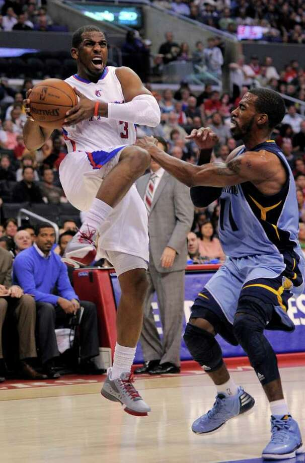 Los Angeles Clippers guard Chris Paul, left, goes up for a shot as Memphis Grizzlies guard Mike Conley defends during the first half of their NBA basketball game, Saturday, March 24, 2012, in Los Angeles. (AP Photo/Mark J. Terrill) Photo: Mark J. Terrill
