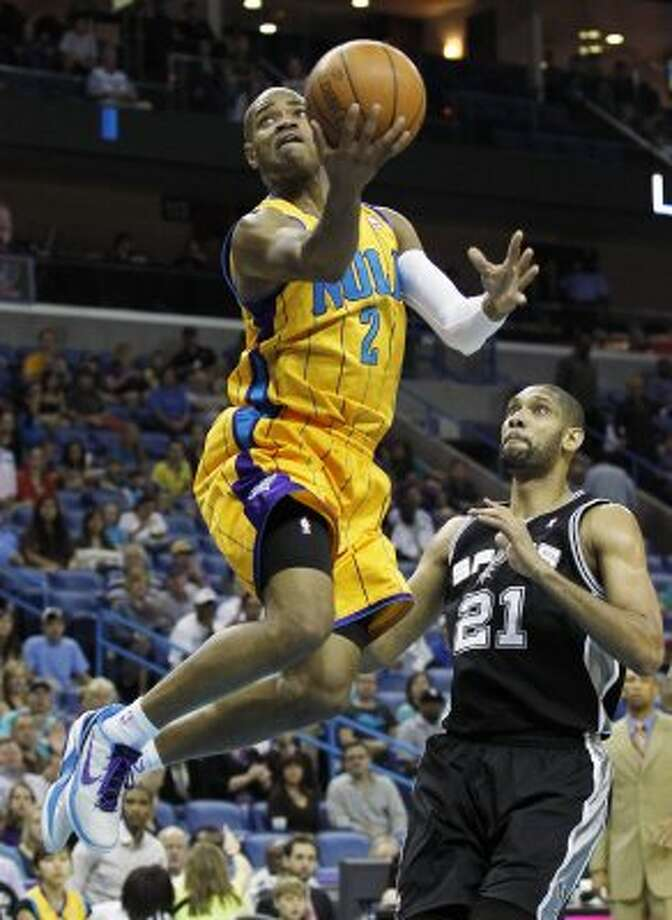 New Orleans Hornets' Jarrett Jack goes to the basket in front of Spurs center Tim Duncan (21) in the first half of an NBA basketball game in New Orleans, Saturday, March 24, 2012. (AP Photo/Bill Haber) (AP)