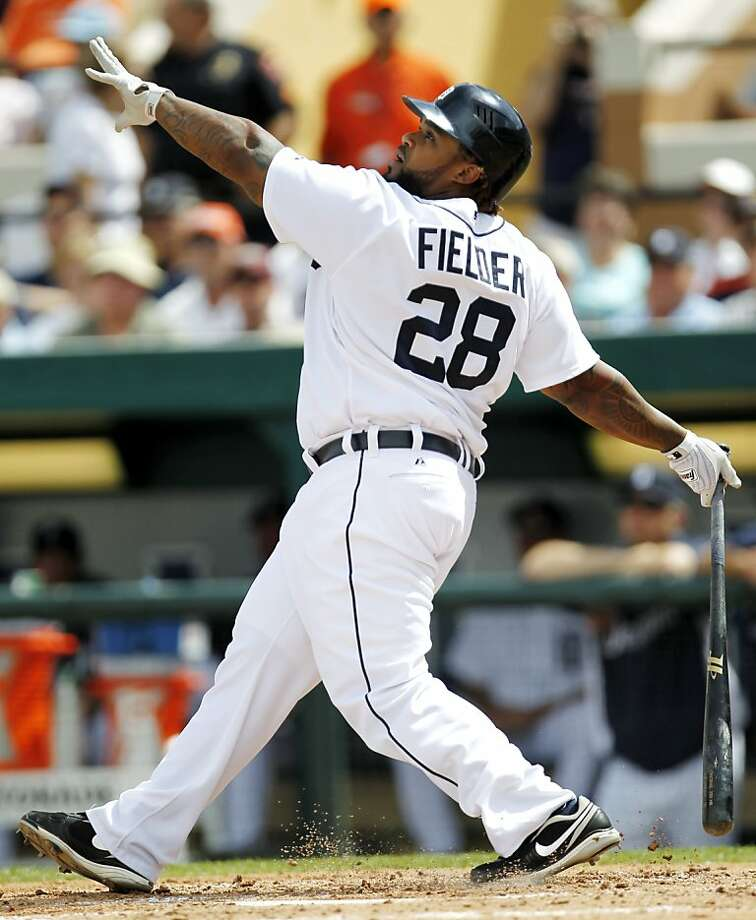 ADVANCE FOR WEEKEND EDITIONS, MARCH 10-11 - FILE - In this March 7, 2012, file photo, Detroit Tigers' Prince Fielder swings on a pitch during the second inning of a spring training baseball game against the Atlanta Braves in Lakeland, Fla. This season, Fielder will be playing in the city where his father slugged homers for the Tigers. Along with the pressure, scrutiny and demands on his time, Fielder will have to deal with realization that fan support is not unconditional. (AP Photo/Julio Cortez, File) Photo: Julio Cortez, Associated Press