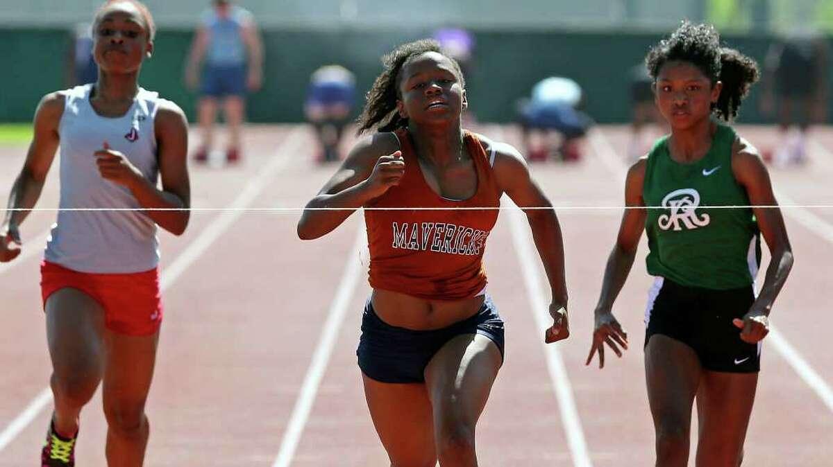 Madison's Yasmin Richards wins the 100 meter in 11.98 over Reagan's Allysha Davis (right) and Judson's Tallajah Murrell during the Alamo Relays at Gustafson Stadium on March 24, 2012. Tom Reel/ San Antonio Express-News