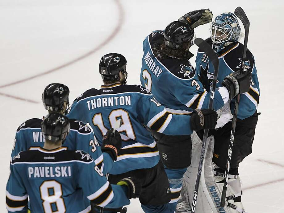 San Jose Sharks goalie Antti Niemi (31), of Finland, is congratulated by teammates after defeating the Phoenix Coyotes 4-3 in an overtime shootout during an NHL hockey game in San Jose, Calif., Saturday, March 24, 2012. Photo: Paul Sakuma, Associated Press
