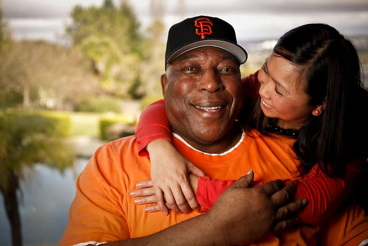 Baseball Hall of Fame Giant Willie McCovey is seen with his girlfriend, Estela Bejar, in his Woodside, Calif., home on Wednesday, Feb. 1, 2012.
