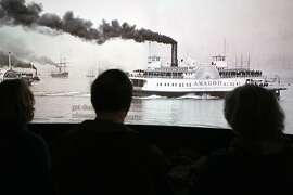 Visitors at the San Francisco Maritime National Historical Park watch a film showing the history of vessels in the Bay Area on Friday, March 23, 2012.