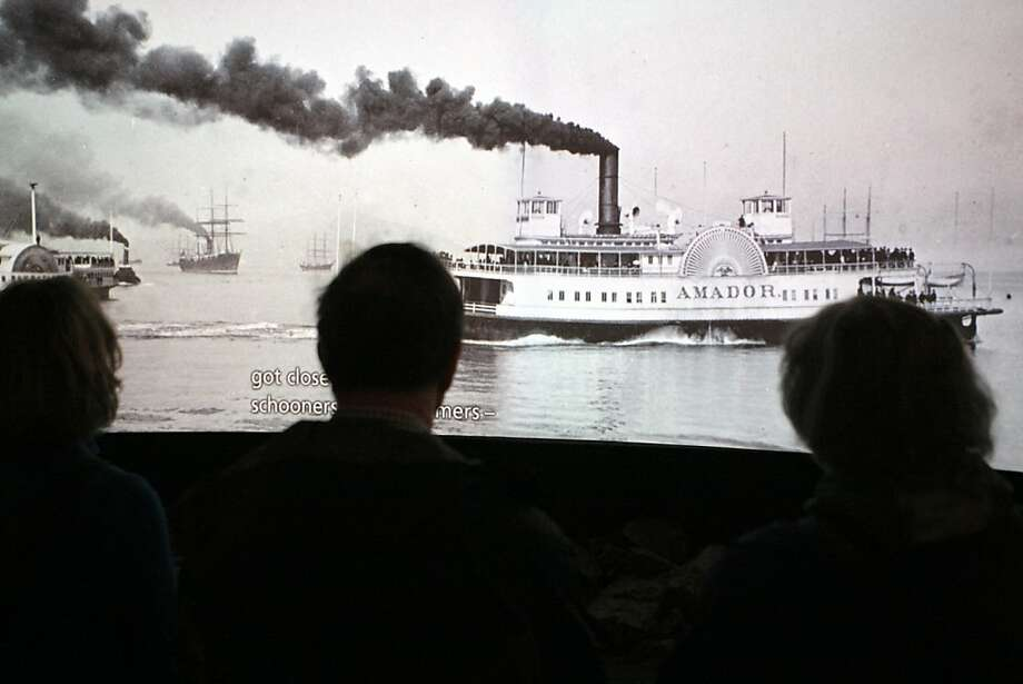 Visitors at the San Francisco Maritime National Historical Park watch a film showing the history of vessels in the Bay Area on Friday, March 23, 2012. Photo: Erik Verduzco, The Chronicle