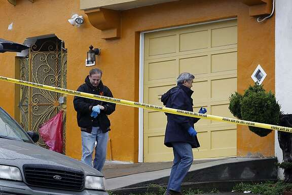 Police investigators continue to search for clues at a home on Howth Street in San Francisco, Calif. on Saturday, March 24, 2012, where five people were found dead on Friday.