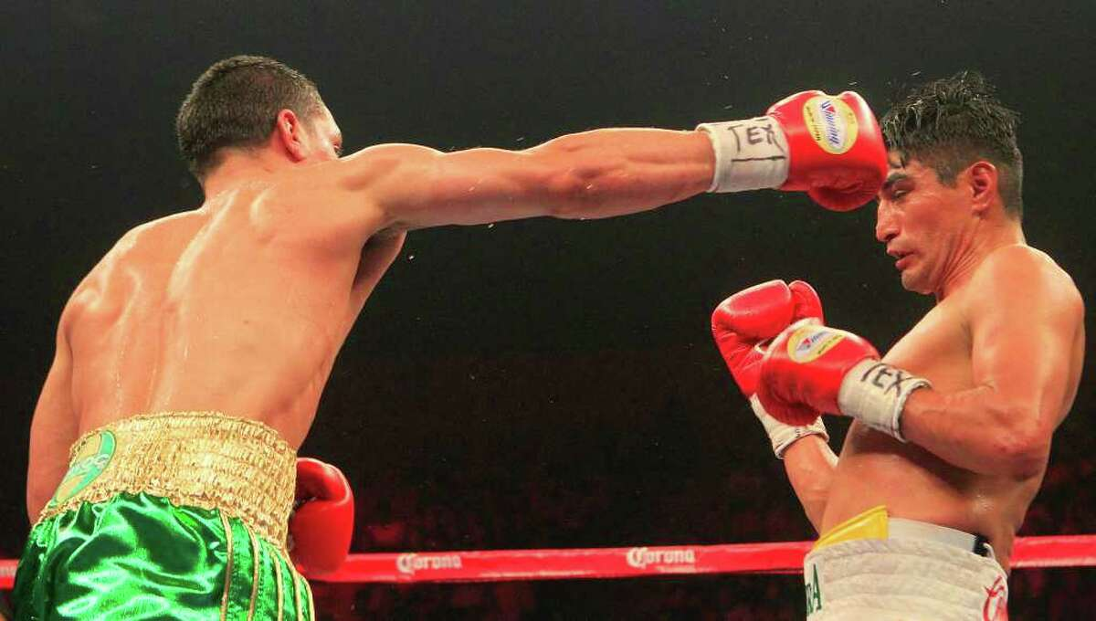 Eric Morales, right, defends his World Boxing Council super lightweight title against Danny Garcia, left, at Reliant ArenaSaturday, March 24, 2012, in Houston.