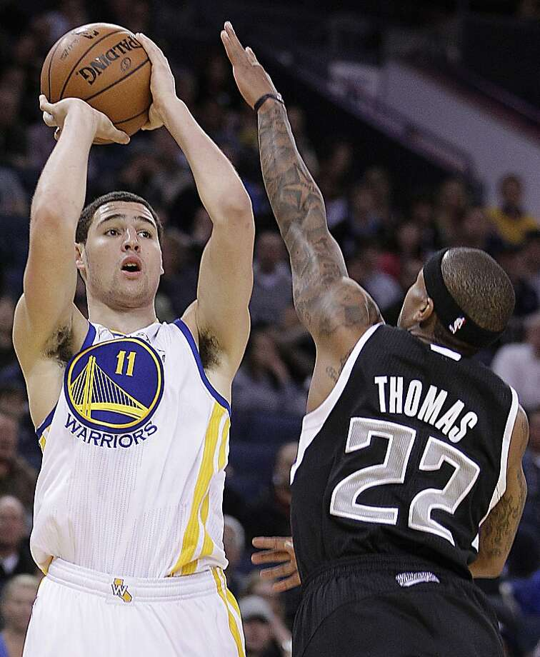 Golden State Warriors' Klay Thompson, left, shoots against Sacramento Kings' Isaiah Thomas (22) during an NBA basketball game Saturday, March 24, 2012, in Oakland, Calif. (AP Photo/Ben Margot) Photo: Ben Margot, Associated Press
