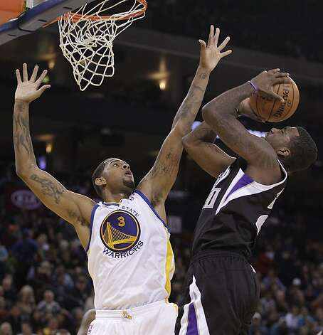 Sacramento Kings' Donte Greene, right, shoots against Golden State Warriors' Jeremy Tyler (3) during the first half of an NBA basketball game Saturday, March 24, 2012, in Oakland, Calif. Photo: Ben Margot, Associated Press