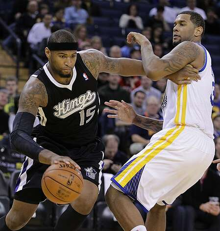 Sacramento Kings' DeMarcus Cousins, left, drives past Golden State Warriors' Jeremy Tyler during the first half of an NBA basketball game Saturday, March 24, 2012, in Oakland, Calif. Photo: Ben Margot, Associated Press