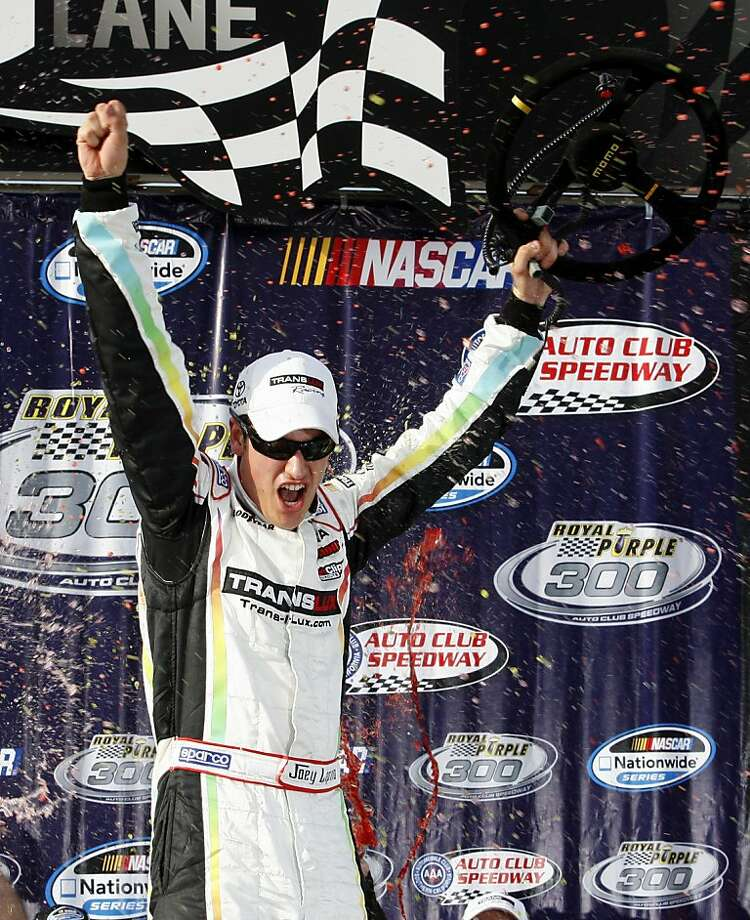 Joey Logano celebrates in victory lane after winning the NASCAR Nationwide Series Royal Purple 300 auto race, Saturday, March 24, 2012, in Fontana, Calif. (AP Photo/LAT, Lesley Ann Miller) Photo: Lesley Ann Miller, Associated Press
