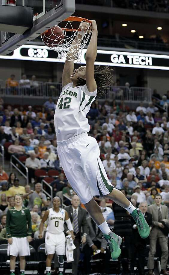 Baylor center Brittney Griner dunks the ball during the second half of an NCAA women's tournament regional semifinal college basketball game against Georgia Tech, Saturday, March 24, 2012, in Des Moines, Iowa. Photo: Charlie Neibergall, Associated Press