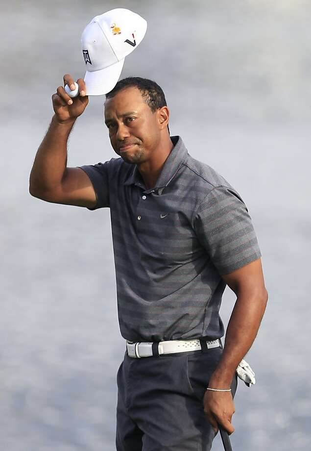 Tiger Woods tips his hat to the gallery after finishing his third round of play at the Arnold Palmer Invitational golf tournament at Bay Hill, Saturday, March 24, 2012, in Orlando, Fla. (AP Photo/John Raoux) Photo: John Raoux, Associated Press