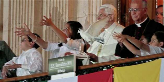 Pope Benedict XVI looks at white doves freed by children on the balcony of the Casa del Conde Rul in Guanajuato, Mexico, Saturday, March 24, 2012.  Benedict arrived in Mexico Friday afternoon, a decade after the late Pope John Paul II's last visit. Benedict's weeklong trip to Mexico and Cuba is his first to both countries.  Photo: Associated Press
