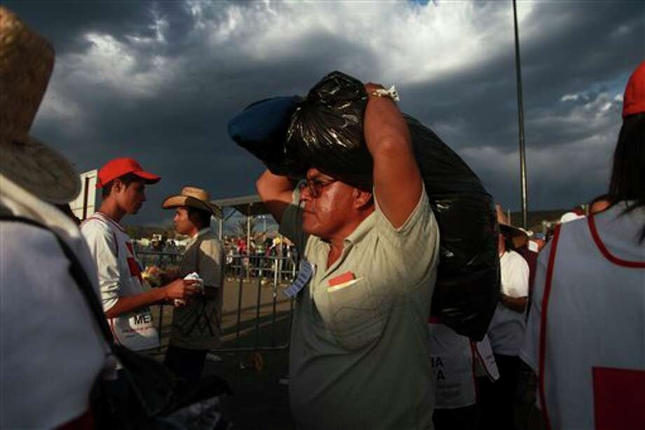 A pilgrim arrives to the site where Pope Benedict XVI will give Sunday Mass at the Bicentennial Park near Silao, Mexico, Saturday March 24, 2012. (AP Photo/Dario Lopez-Mills) Photo: Associated Press