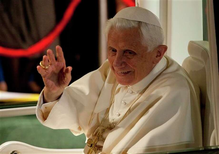 Pope Benedict XVI  waves from the popemobile after a symbolic key ceremony in Leon, Mexico, Saturday March 24, 2012. Benedict arrived in Mexico Friday afternoon, a decade after the late Pope John Paul II's last visit. The pontiff's weeklong trip to Mexico and then to Cuba on Monday is his first to both countries. (AP Photo/Eduardo Verdugo) Photo: Associated Press