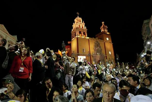 Faithful listen to Pope Benedict XVI's message in the Plaza de la Paz or Peace Plaza in Guanajuato, Mexico, Saturday March 24, 2012.  The pope reserved his only public remarks Saturday for a gathering of about 4,000 children and their parents massed in the Plaza de la Paz or Peace Plaza.  Photo: Associated Press