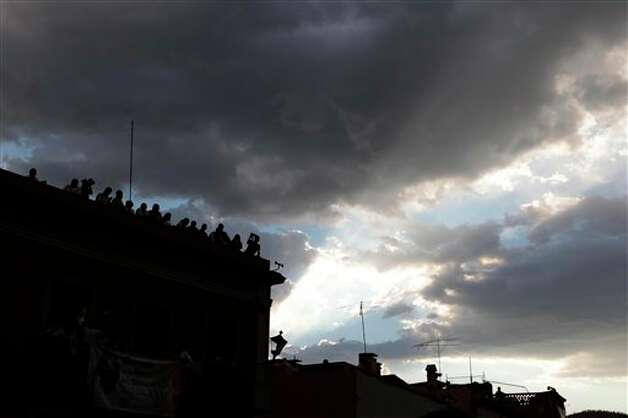 Faithful wait for the arrival of Pope Benedict XVI in Guanajuato, Mexico, Saturday March 24, 2012. Benedict arrived in Mexico Friday afternoon, a decade after the late Pope John Paul II's last visit. Benedict's weeklong trip to Mexico and Cuba is his first to both countries.  Photo: Associated Press