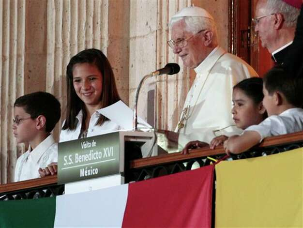 Pope Benedict XVI speaks from the balcony of the Casa del Conde Rul palace in Guanajuato, Mexico, Saturday, March 24, 2012.  Benedict arrived in Mexico Friday afternoon, a decade after the late Pope John Paul II's last visit. Benedict's weeklong trip to Mexico and Cuba is his first to both countries.  Photo: Associated Press
