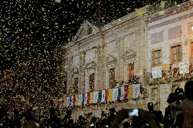 Confetti rains on the crowd gathered in the Plaza de la Paz or Peace Plaza, at the end of Pope Benedict XVI's speech in Guanajuato, Mexico, Saturday March 24, 2012. At the entrance to Guanajuato, Benedict received the keys to the city. The pope reserved his only public remarks Saturday for a gathering of about 4,000 children and their parents massed in the plaza. Photo: Associated Press