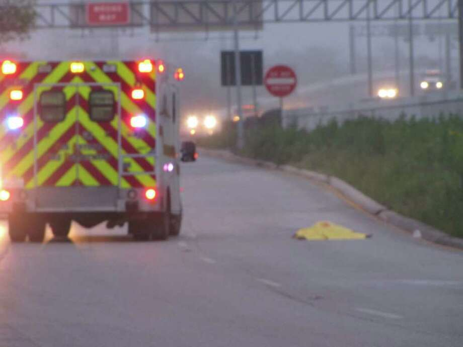 A San Antonio Fire Department ambulance and police vehicles block the scene of a crash that killed a pedestrian on the West Side early Sunday. Photo: Eva Ruth Moravec; Emoravec@express-news.net / emoravec@express-news.net