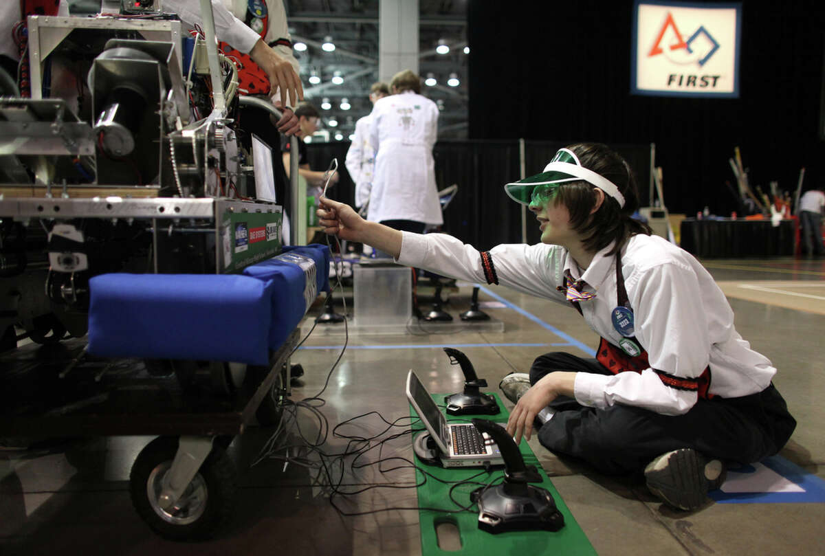 Jake Small of Central Kitsap High School prepares his school's robot during the FIRST Robotics regional