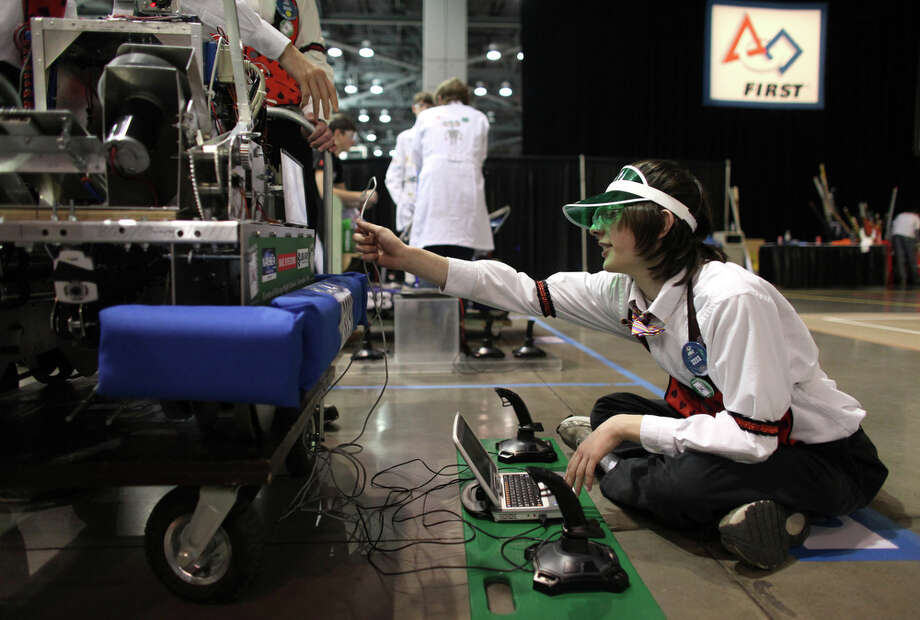 "Jake Small of Central Kitsap High School prepares his school's robot during the FIRST Robotics regional ""Rebound Rumble"" robotics competition on Friday, March 23, 2012 at CenturyLink Field Events Center. 92 high school robotics teams and 2,500 students competed in the event. Students had 6 weeks to construct a remote controlled robot that competed in a 3-on-3 basketball tournament. Photo: JOSHUA TRUJILLO / SEATTLEPI.COM"