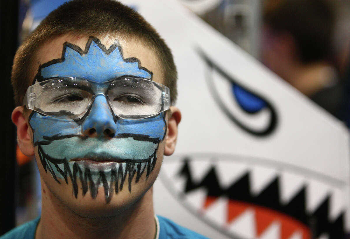Christian Ziruk of Tacoma's Science and Math Institute sports face paint during the FIRST Robotics regional