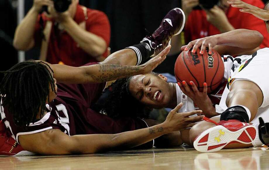 March 25: Maryland 81, Texas A&M 74- Maryland's Alyssa Thomas, right, and Texas A&M's Tyra White struggle for a loose ball. Photo: Gerry Broome, Associated Press / AP