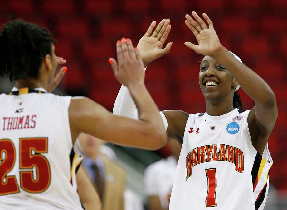 Maryland's Alyssa Thomas (25) and Laurin Mincy (1) react following an NCAA college women's tournament regional semifinal basketball game against Texas A&M in Raleigh, N.C., Sunday, March 25, 2012. Maryland won 81-74. (AP Photo/Gerry Broome) Photo: Gerry Broome, Associated Press / AP