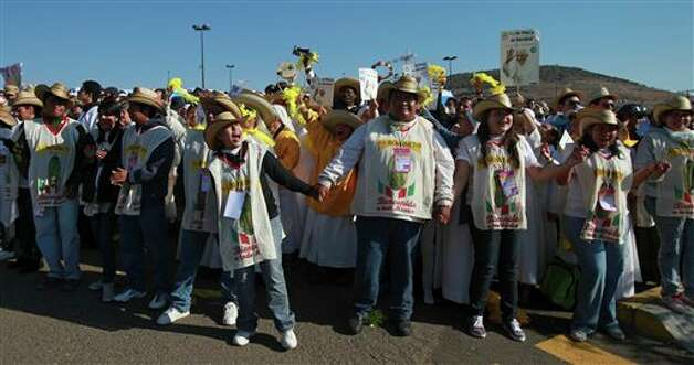 Pilgrims cheer and sing as they wait at the site where Pope Benedict XVI will give a Mass in Bicentennial Park near Silao, Mexico, Sunday March 25, 2012.  Photo: Dario Lopez-Mills, Associated Press / AP