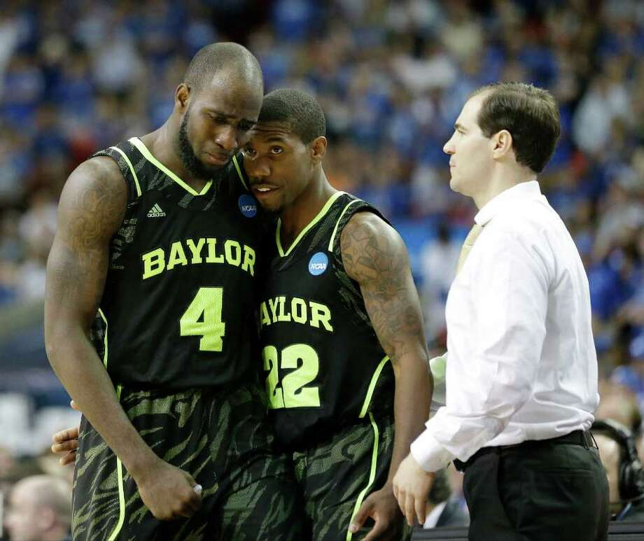 Baylor's Quincy Acy (4) and Baylor's A.J. Walton (22) walk by Baylor head coach Scott Drew in the closing seconds of the second half of an NCAA tournament South Regional finals college basketball game against Kentucky ,Sunday, March 25, 2012, in Atlanta. Kentucky won 82-70. (AP Photo/David J. Phillip) Photo: David J. Phillip, Associated Press / AP