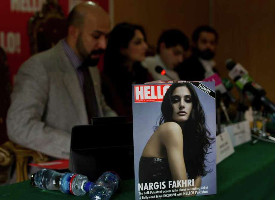 The editorial staff of Hello magazine address a news conference during its launching ceremony at National Press Club in Islamabad, Pakistan on Saturday, March 24, 2012. Pakistan is better known for bombs than bombshells, militant compounds than opulent estates. A few enterprising Pakistanis hope with the launch of a local version of the well-known celebrity magazine Hello! (AP Photo/B.K. Bangash) Photo: B.K. Bangash / AP