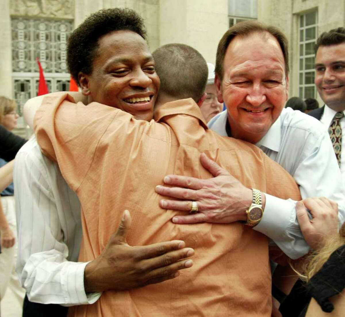 Tyron Garner, left, and John Geddes Lawrence, right, are hugged by a well-wisher after a rally at Houston City Hall in 2003 held to celebrate the Supreme Court ruling striking down a Texas law that bans gay sex acts. Lawrence and Garner were prosected in Houston under Texas' sodomy law in 1998 and the case became the test case. But the law itself remains on the books.
