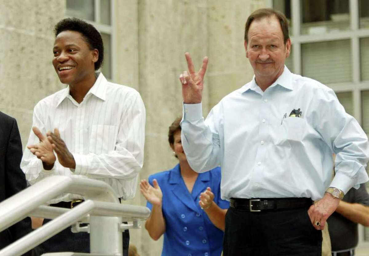 Tyron Garner, left, and John Geddes Lawrence acknowledge applause at a rally Thursday, June 26, 2003, at City Hall in Houston after the U.S. Supreme Court struck down a Texas law that made homosexual sex a crime.