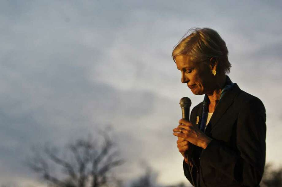Cecile Richards, speaking to Planned Parenthood supporters in an Austin parking lot, is Ann Richards' daughter. Photo: AP