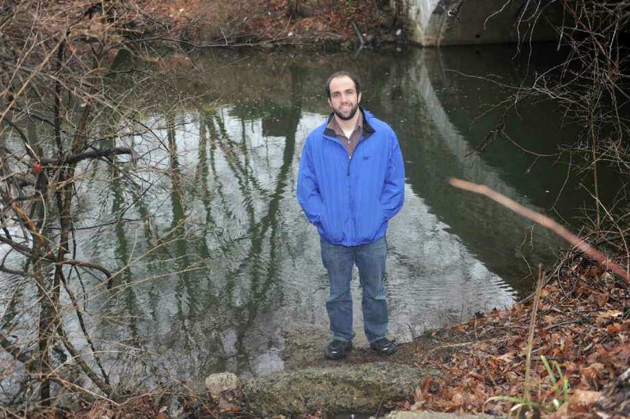 Town Conservation Assistant Joe Cassone stands near the Byram River in Glenville Thursday, March 1, 2012. Cassone is leading the installation and oversight of an eel pass on the Byram River. Photo: Helen Neafsey / Greenwich Time
