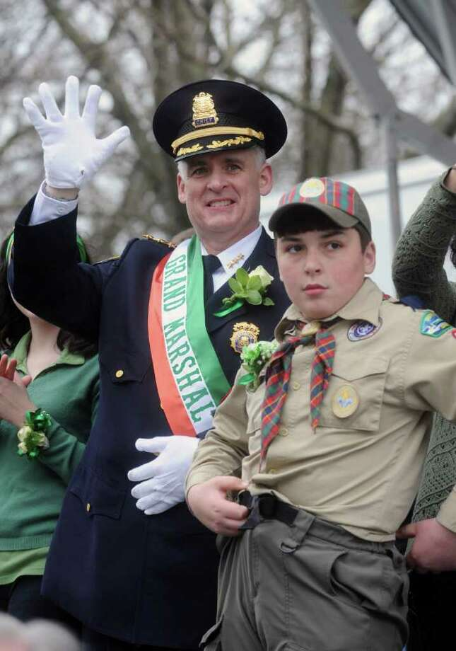 Grand Marshall Police Chief James Heavey and his son Jamie wave from the bandstand at the St Patrick's Day Parade in Greenwich, Conn. on Sunday March 25, 2012 as it proceeds down Greenwich Ave. Photo: Dru Nadler / Stamford Advocate Freelance