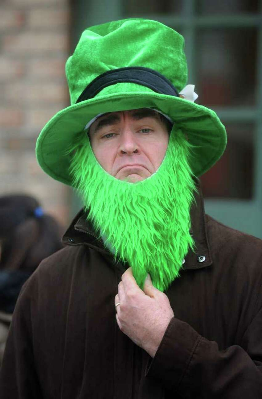 Mace Perlman watches the St Patrick's Day Parade in Greenwich, Conn. on Sunday March 25, 2012.