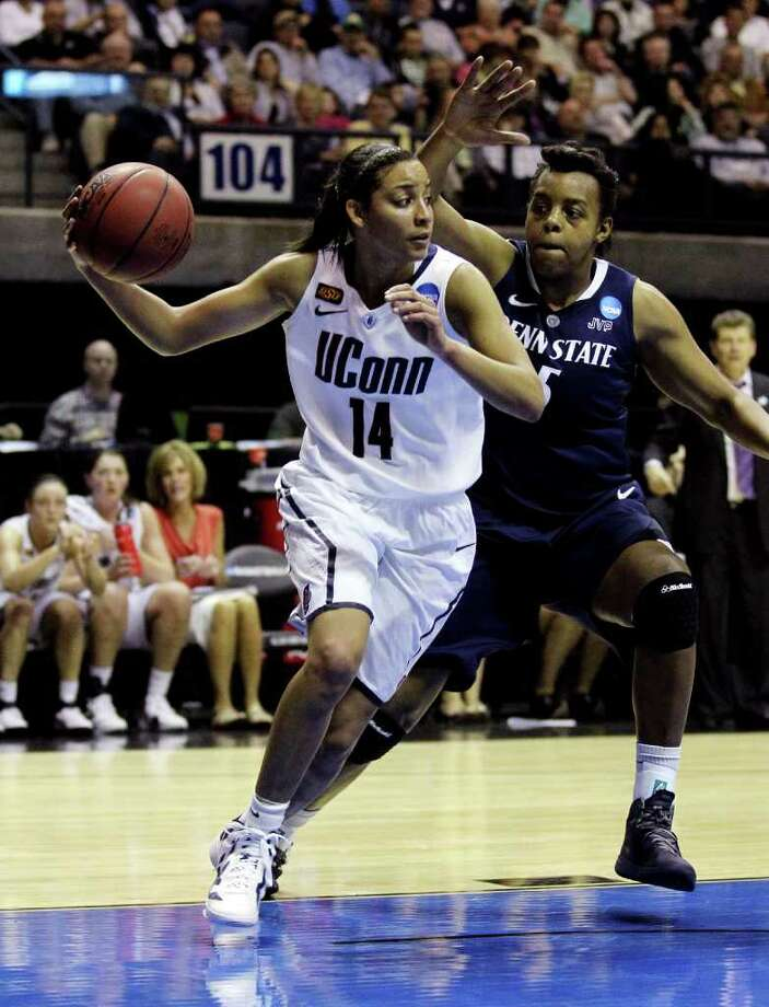 Penn State forward Talia East (5) defends against Connecticut guard Bria Hartley (14) during the second half of an NCAA women's tournament regional semifinal college basketball game in Kingston, R.I., Sunday, March 25, 2012. Connecticut won 77-59. (AP Photo/Stew Milne) Photo: Stew Milne, Associated Press / FR56276 AP